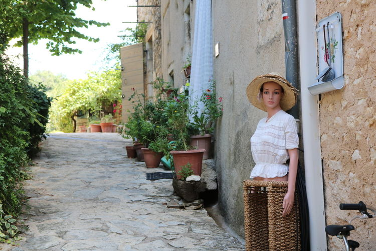 meeting with the lovely female torso Antiquarian Junk Dealer Female Torsoes Female Torso Mannequin Old Buildings Old Village South Of France Tree Child Girls Standing Architecture Building Exterior Sun Hat Open Door