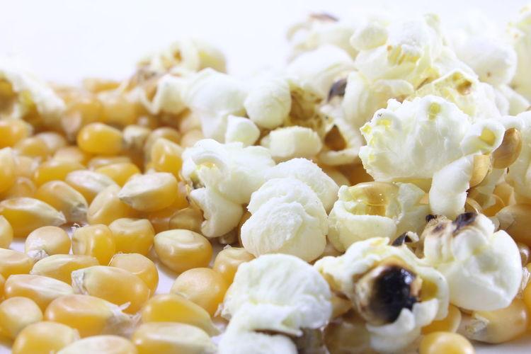 Corn kernels for making popcorn on a white background. Corn Kernels For Making Popcorn On A White Background.