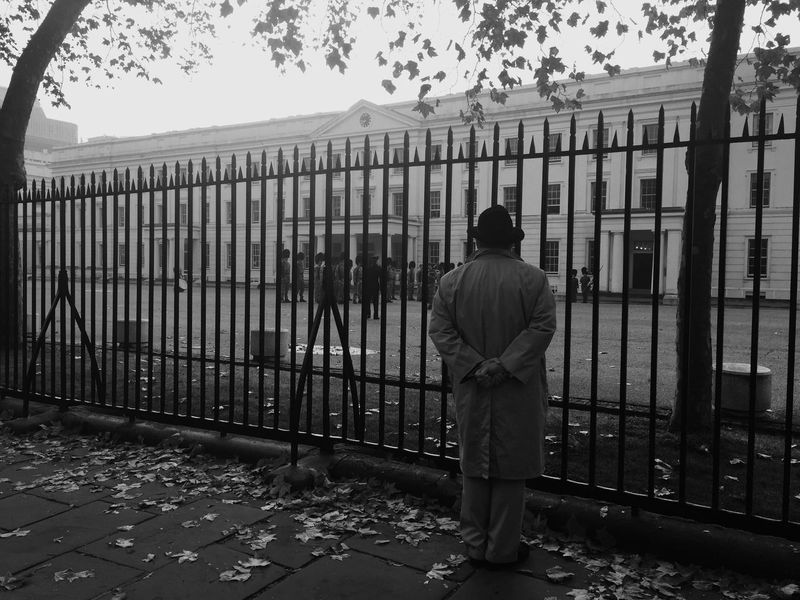 Alone Black And White Dapper Diminishing Perspective Fence Gentleman  Honor Ironwork  Lifestyles London Looking Marching Band Memory Observing Old Age Outside Respect Royal Barracks Royal Guard Sidewalk Wistful Pmg_lon