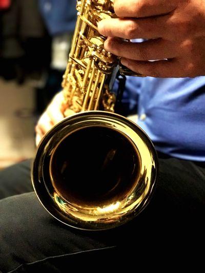 Saxamaphone Music Musical Instrument One Person Musician Arts Culture And Entertainment Saxophone Playing Midsection Holding Person Brass Instrument  Real People Skill  Trumpet Men Indoors  Close-up Jazz Music Human Body Part