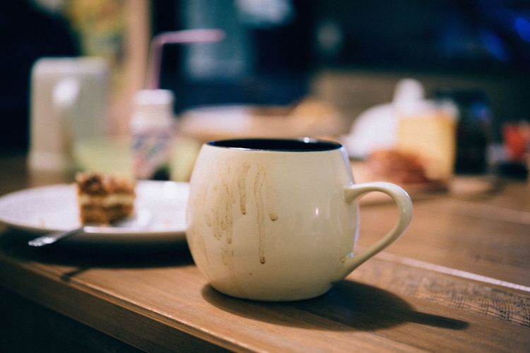 A cup of coffee. Food And Drink Table Cup Drink Mug Refreshment Still Life Wood - Material Indoors  Coffee Cup Focus On Foreground No People Freshness Close-up Coffee Coffee - Drink Food Business Hot Drink Saucer Non-alcoholic Beverage Crockery Tea Cup Latte Tray