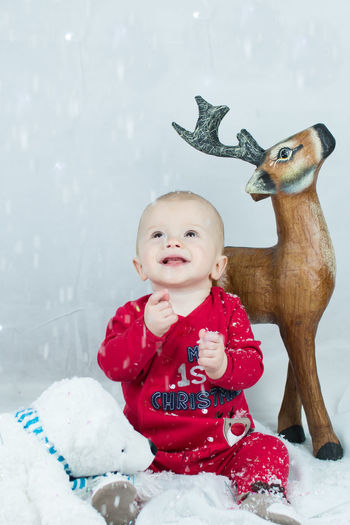 Joyful snow Babies Only Baby Baby Photoshoo Babyhood Cheerful Childhood Christmas Fun Cute Baby Day Festive Fun Full Length Happy Baby Indoors  Let It Snow One Person People Red Smiling Snow Snowflake Snowing Streamzoofamily Winter The Portraitist - 2017 EyeEm Awards