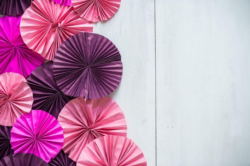 Close-up of multi colored umbrella on wall