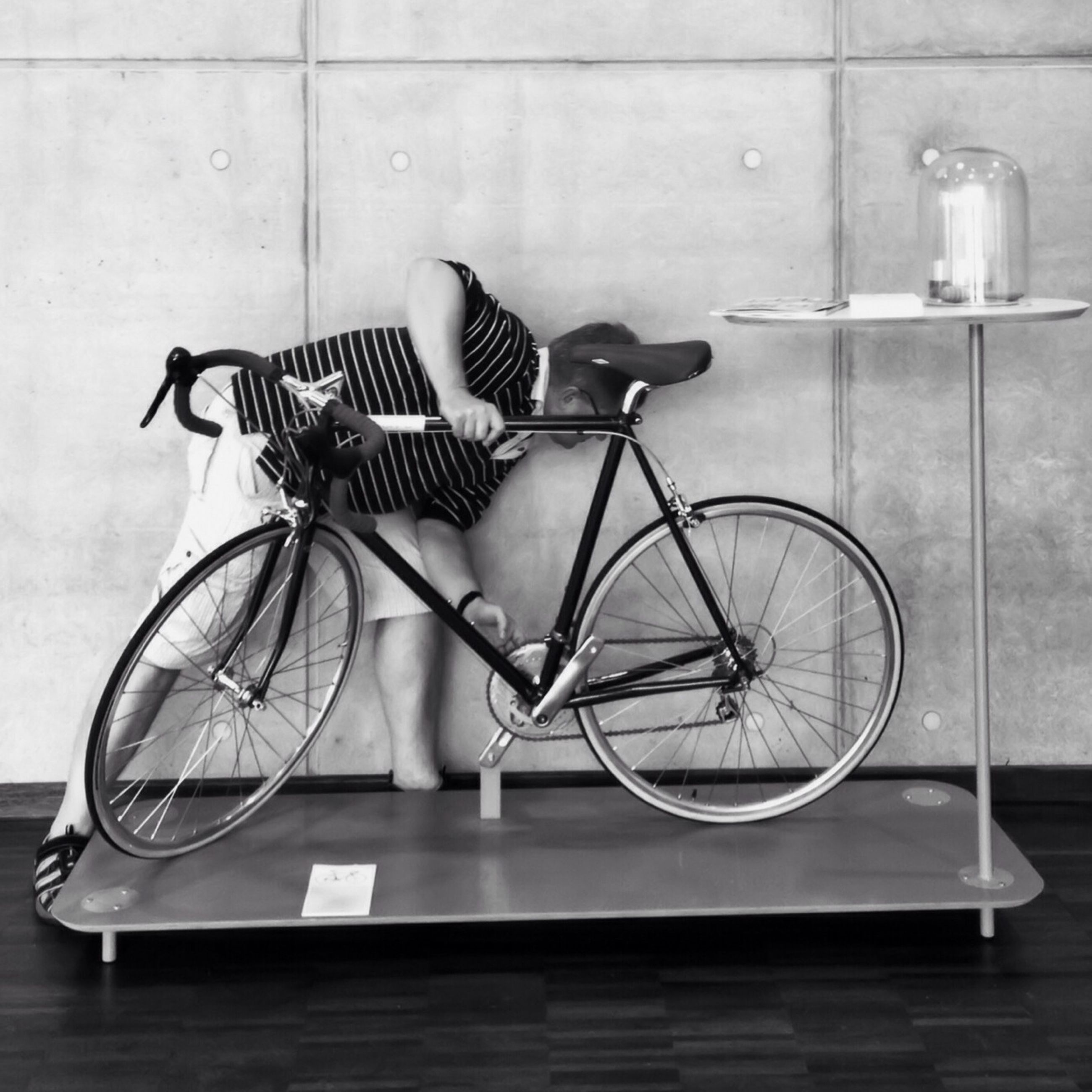bicycle, indoors, absence, wall - building feature, metal, built structure, chair, stationary, wall, table, architecture, no people, empty, railing, day, still life, parking, high angle view, parked, side view
