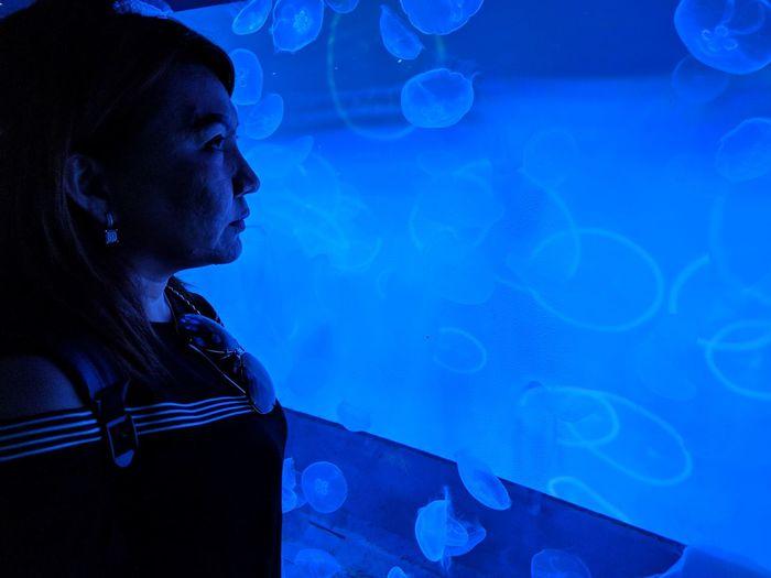 Woman looking at aquarium