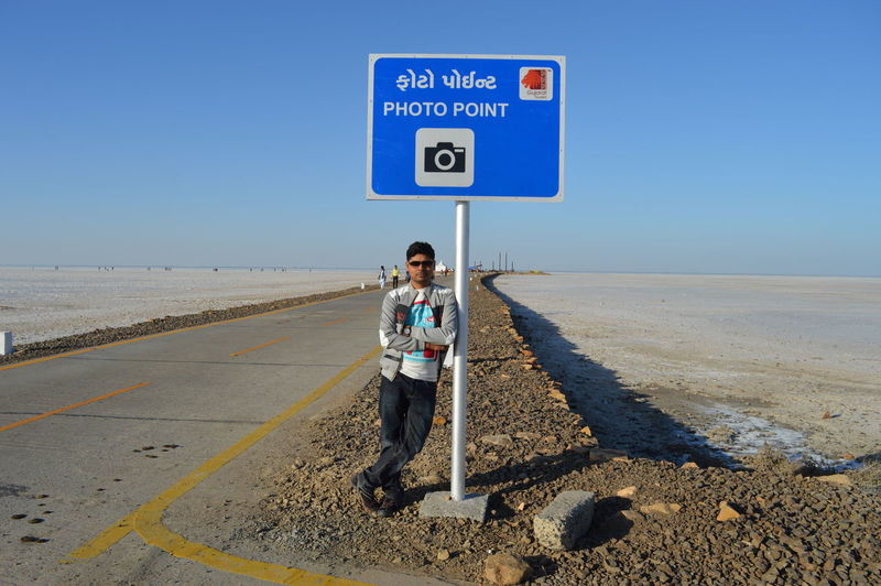 Photo with the photo board!! Rann Of Kutch Solo Trip Solo Traveler! Adult Adults Only Bhuj_kutch Blue Clear Sky Day Full Length Love Yourself Men Nature One Person Outdoors People Portrait Road Road Sign Transportation White Desert Kutch. Young Adult
