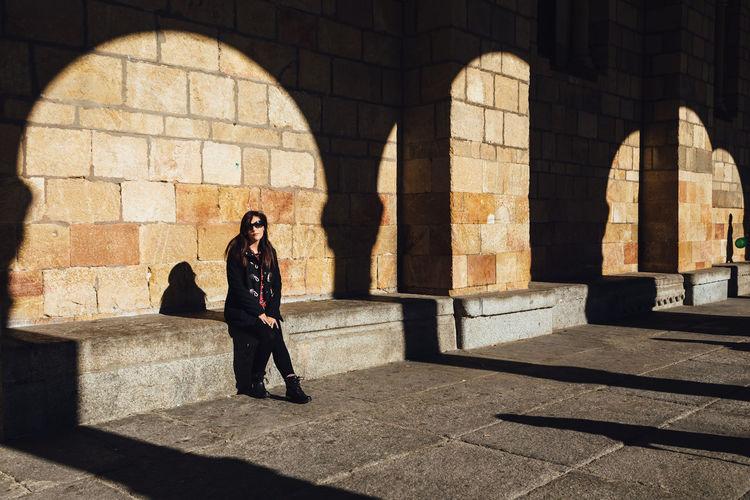 Woman Sitting On Seat At Avila