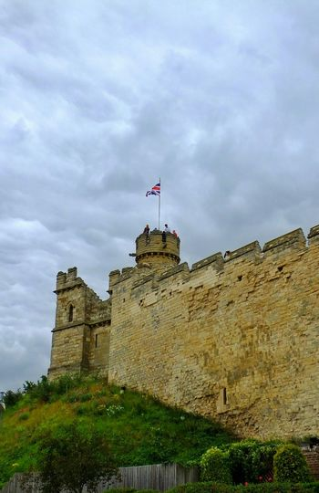 Part of the Castle Wall of Lincoln Castle and Castle Tower flying the Union Flag