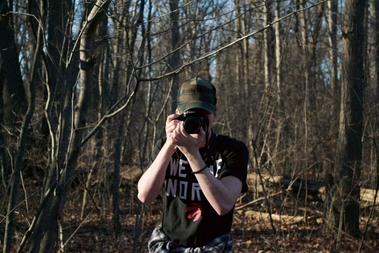 Tree Holding Forest Standing One Person Mid Adult One Man Only Photography Themes Branch Men Camera - Photographic Equipment Flat Cap Outdoors Adults Only Nature Day People Adult Only Men EyeEmNewHere