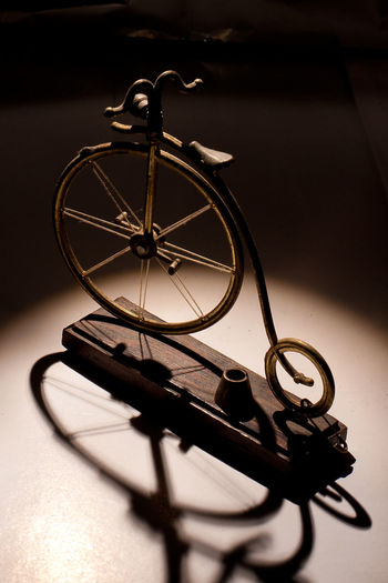 High Angle View Of Penny-Farthing Bicycle Show Piece On Table