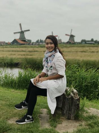 Holland Windmill Windmills Wind Energy Photography Portrait Of A Woman Portrait Fashion One Person Sitting One Woman Only Beauty Young Adult Long Hair Beautiful Woman Grass Waterfront Zaanse Schans Zaanseschanswindmill Zaanse_schans Model Pose Model Photography Photos Around You Photo Of The Day Photoshoot