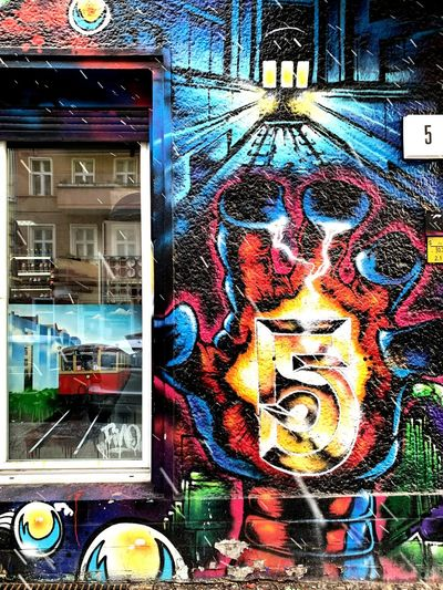 Graffiti on the streets of Berlin Art Colors Culture Vibrant Color Artist Graffiti Building Exterior Built Structure No People Architecture Graffiti Art And Craft Creativity Window Glass - Material Multi Colored Human Representation City Outdoors