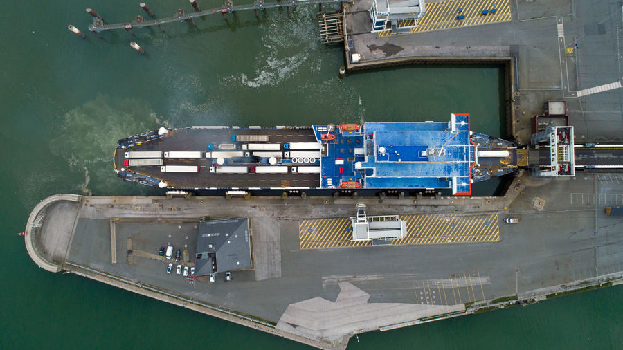 Aerial photography of a ferry boat docked in Calais port, France Ferryboat France Pas De Calais Smoke Aerial Photography Aerial View Blue Calais  Canal Cargo Container Container Dock Ferry Boat Freight Transportation French High Angle View Industry Nautical Vessel Pier Port Shipping  Transportation Truck Water Waterfront