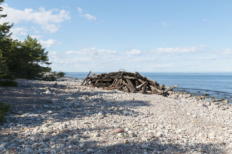 The wreck Swiks on Öland, Sweden Coastline Sweden Wreck Abandoned Beach Beauty In Nature Blue Broken Cloud - Sky Damaged Day Driftwood Landscape Nature No People Outdoors Sand Scenics Sea Sky Sunlight Tranquility Water Wood - Material Öland Breathing Space Summer Exploratorium