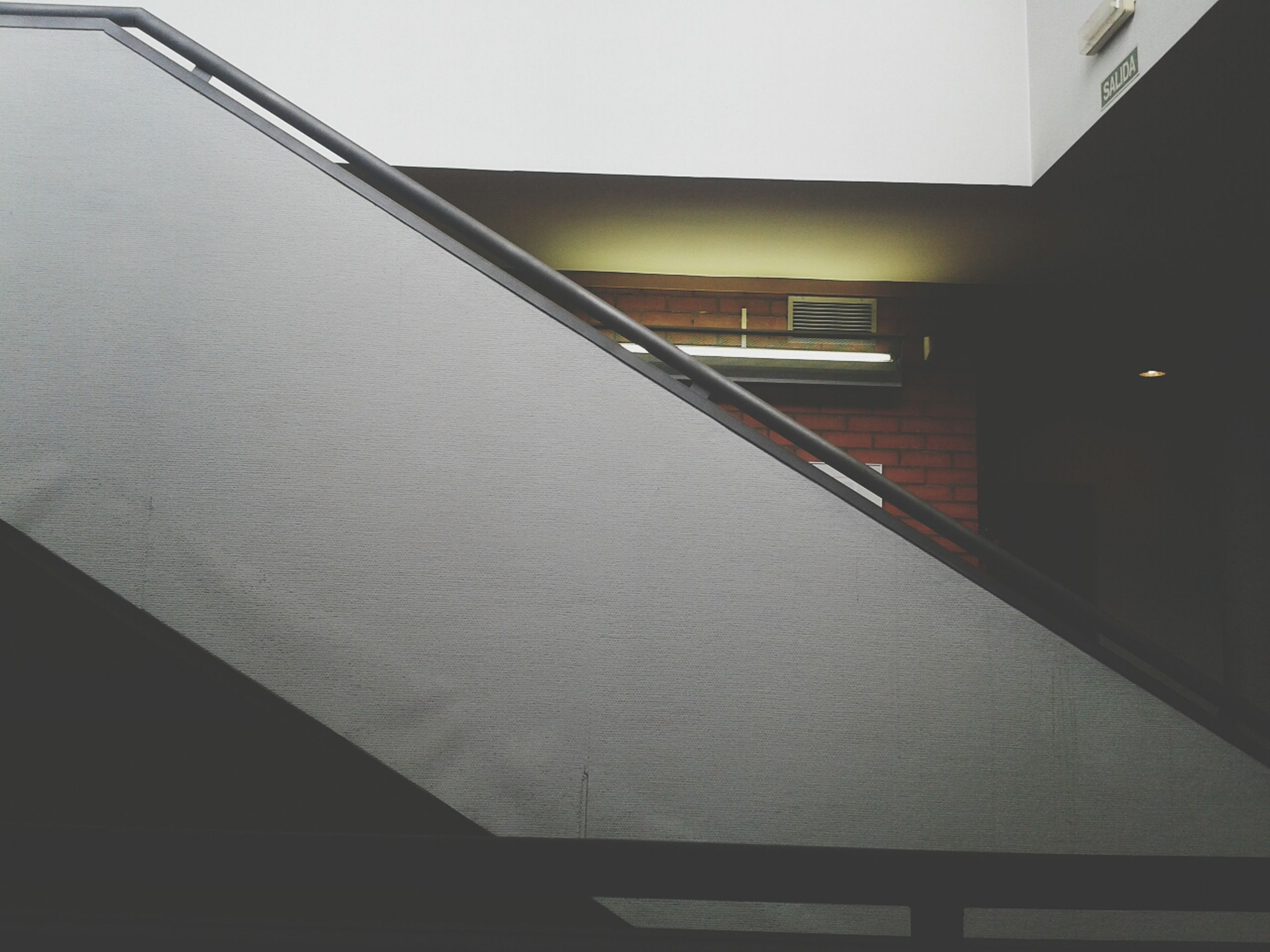 architecture, built structure, indoors, building, low angle view, building exterior, staircase, railing, modern, steps, ceiling, steps and staircases, no people, wall - building feature, diminishing perspective, empty, day, copy space, the way forward, absence
