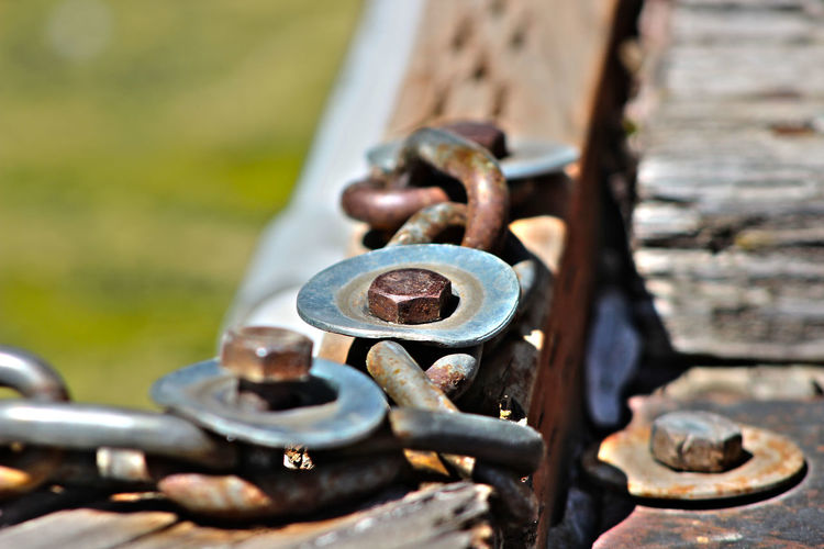 A Chain Reaction Metal Rusty Close-up Outdoors Day Bolt No People Nut - Fastener