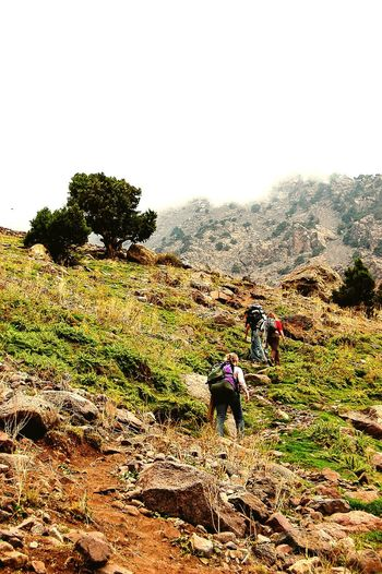 To the top Travel Morocco MoroccoTrip Rocky Mountains Adventure Trek High Atlas Morocco Mountains Atlasmountains Hiking Friends Adventure Buddies The Tourist Fog Mist Altitude Trekking Three Backpacker Travel Photography Holiday The KIOMI Collection