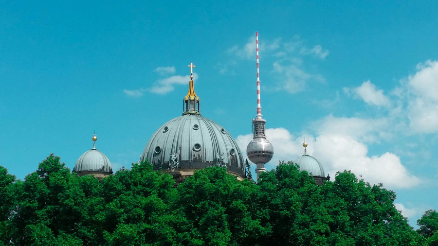 Low angle view of berlin cathedral and fernsehturm against sky