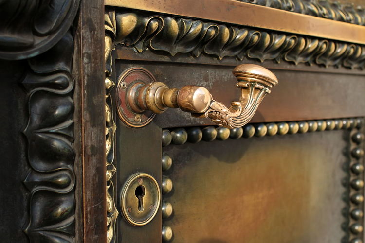 Ancient door reliable protection close to Door Entrance Close-up Gold Colored Architecture Antique Pattern Art And Craft Old Bronze - Alloy Gold History Ornate