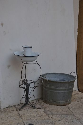 Wall - Building Feature No People Container Indoors  Domestic Room Still Life Day Absence Nature Bucket Household Equipment Flooring Abandoned Old Built Structure Toilet Bowl Bathroom Architecture Crockery Table