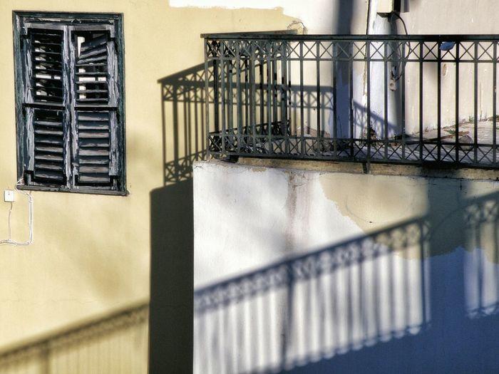 Shadow of railing on building wall