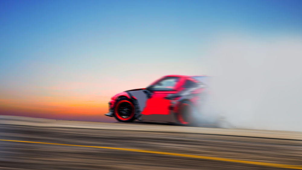 Blurred Speed Tracking Blurred Motion Car Copy Space Driftting Driftwood Land Vehicle Long Exposure Mode Of Transportation Motion Motor Vehicle on the move Outdoors Red Road Trip Sky Speed Sport Track Transportation