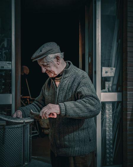 Man standing by window in winter