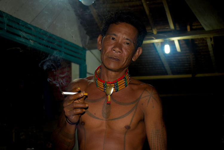 Siberut Island Mentawai-Indonesia Sikerei Mentawai Ritual Portrait Headshot Arts Culture And Entertainment Individuality Necklace Smiling Jewelry Cheerful