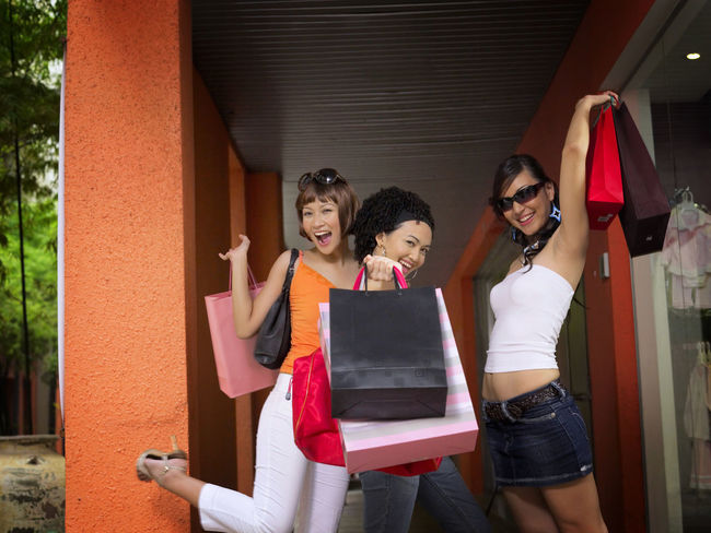 shopping at clothing store Asian  Business Fashion Free Time Fun Happiness Shopping Clothing Store Consumerism Discount Enjoying Life Female Friendship Fun Time Garment Hapiness Leisure Activity Lifestyles Sales Shopping Bag Shopping Mall Smiling Standing Weekend Activities Women