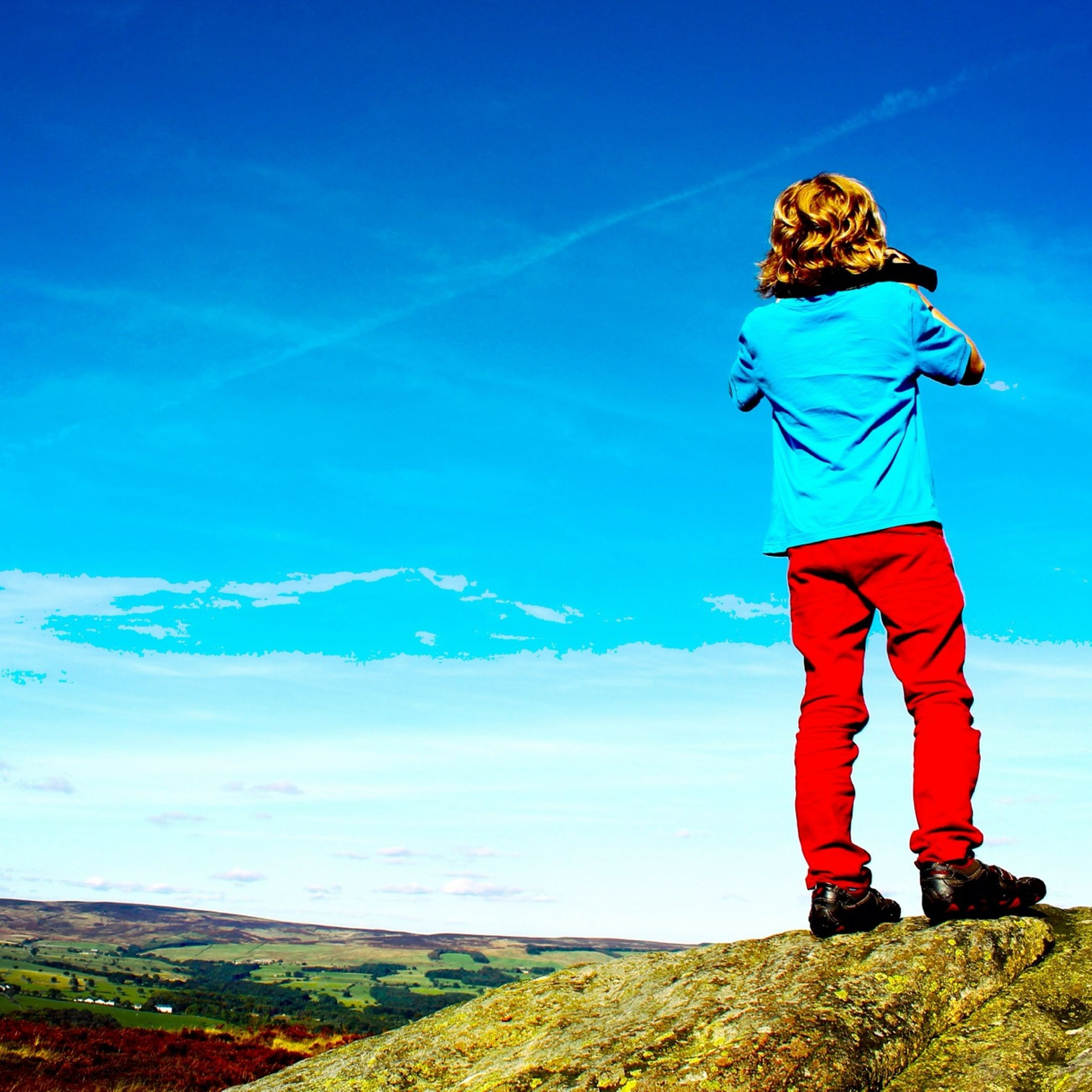 blue, leisure activity, lifestyles, standing, full length, casual clothing, sky, tranquility, rear view, tranquil scene, men, landscape, mountain, nature, person, beauty in nature, day, scenics