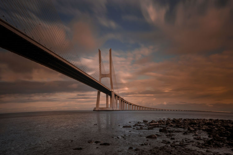 Architecture Beach Beauty In Nature Bridge - Man Made Structure Built Structure Cloud - Sky Connection Day Horizon Over Water Nature No People Outdoors Scenics Sea Sky Sunset Suspension Bridge Tranquil Scene Transportation Travel Travel Destinations Water