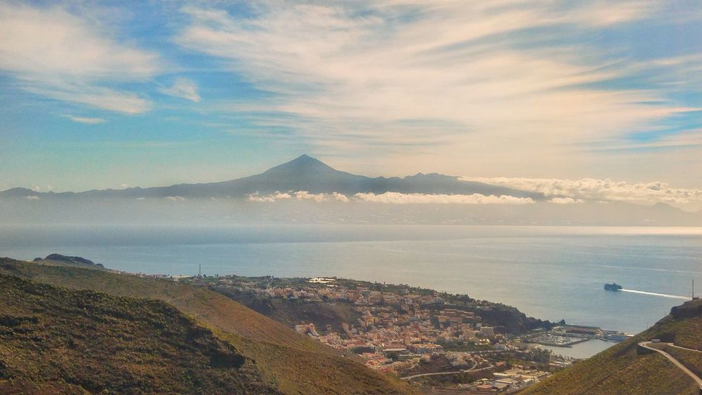 Mountain High Angle View Sky Cloud - Sky Aerial View SunsetBeauty In Nature No People Outdoors Sunlight Day Nature Mountain Range Scenics Canary Islands Volcanic Beach Volcanic Island La Gomera Tenerife Ocean View Mountains And Clouds architecture Sea Building Exterior City Beauty In Nature The Great Outdoors - 2017 EyeEm Awards The Great Outdoors - 2017 EyeEm Awards