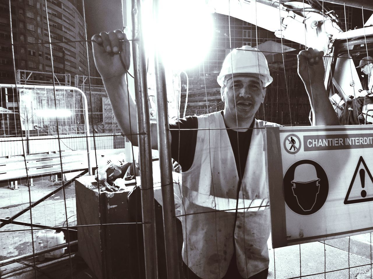 real people, one person, looking at camera, front view, portrait, standing, occupation, mid adult men, mid adult, young adult, manual worker, reflective clothing, indoors, headwear, day, hardhat, people