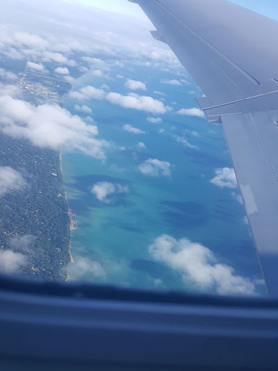Cloud - Sky Airplane Travel No People Sky Journey Blue Nature Day Scenics Outdoors Vacations Water Beauty In Nature Horizon Over Water Lake Michigan