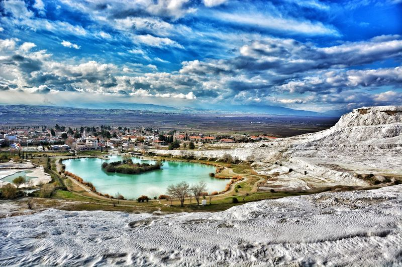 Pamukkale/Turkey Calcium Deposits Natural Beauty Cloud - Sky Sky Water Outdoors Day Architecture No People Nature Building Exterior Mountain Scenics Landscape Beauty In Nature