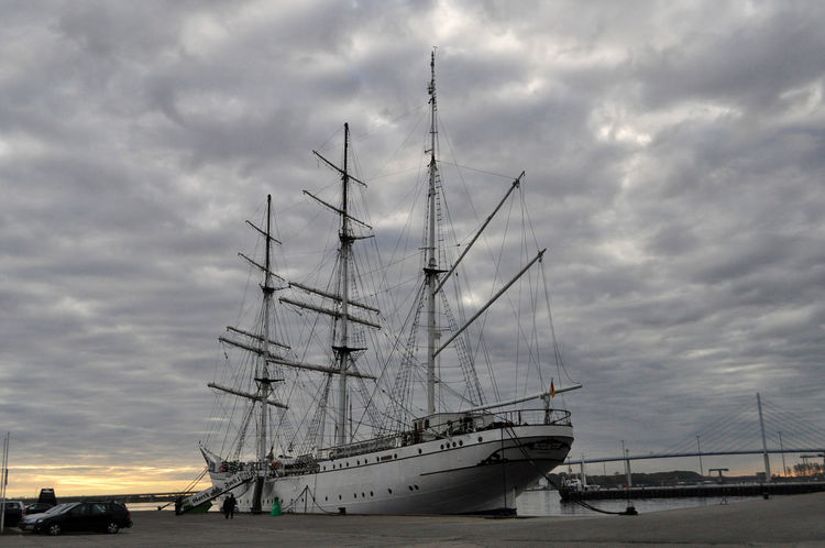 Gorch Fock Schiff Boat Cloud - Sky Commercial Dock Day Freight Transportation Harbor Mast Mode Of Transport Moored Nature Nautical Vessel No People Outdoors Sailboat Sailing Sailing Ship Sea Ship Sky Storm Cloud Stralsund Hafen Sunset Tall Ship Transportation Travel Destinations Water