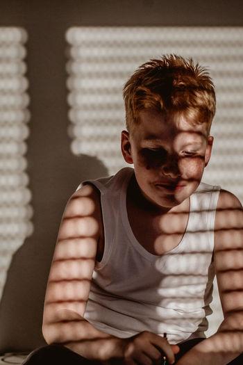 Portrait of teenage boy sitting at home