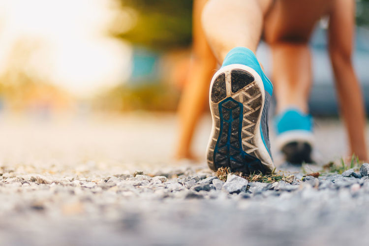 Activity Adult Body Part Close-up Effort Exercising Healthy Lifestyle Human Body Part Human Foot Human Leg Human Limb Lifestyles Limb Low Section One Person Outdoors Selective Focus Shoe Sole Of Shoe Sport Sports Shoe Surface Level
