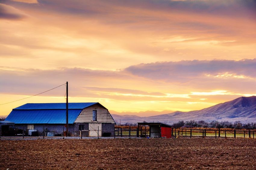 Old barn and shed up in the mountains at sunset Sky Nature Beauty In Nature Sunset Scenics Cloud - Sky Sand Outdoors No People Tranquility Built Structure Landscape Architecture Day Mountain (null)Landscapes Beauty In Nature Sunsets Sunsetlovers Sunset Colors Farm Farm Life Farmland Farmlife