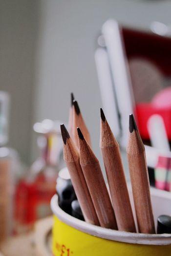 Close-Up Of Wooden Pencils In Desk Organizer