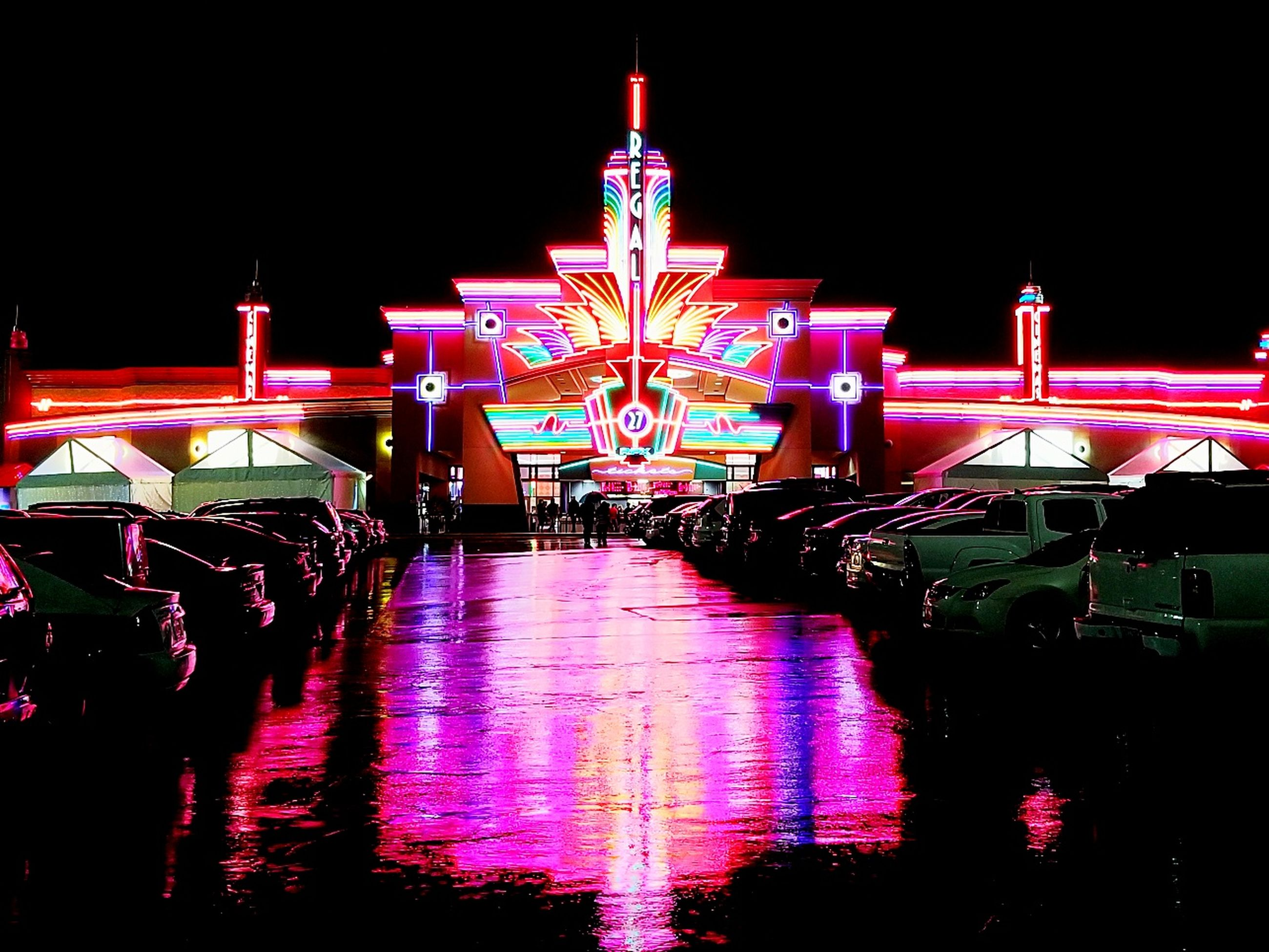 night, illuminated, amusement park, multi colored, outdoors, amusement park ride, arts culture and entertainment, architecture, built structure, clear sky, no people, travel destinations, sky, carousel, building exterior, water