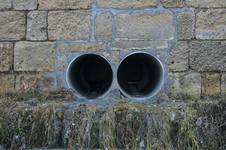 Sewage Pipes On Wall