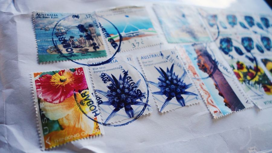 Close-up of vintage mail envelope with postage stamps