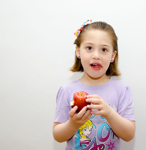 Little beauty with an Aplle Apple Architecture Beauty Food Hands Hangin Indoor Isolated White Background Little Girl People White Background