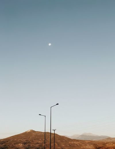 Let the moon be your guide Minimalism Sky Moon Nature Beauty In Nature Tranquil Scene Scenics - Nature No People Tranquility Clear Sky Technology Outdoors Copy Space Environment Landscape Non-urban Scene Horizon Night Land Lighting Equipment 2018 In One Photograph