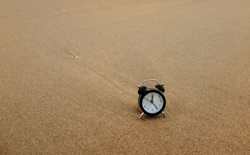 Concept of Time Clock on the beach Minute Hand Clock Time Roman Numeral Clock Face Beach Sand Hour Hand Backgrounds Textured  Instrument Of Time Wall Clock Second Hand Time Zone 12 O'clock Stopwatch Number 12 Countdown Timer Circular Pocket Watch Shore Clock Hand Clockworks Pebble Beach Hourglass Pebble Wristwatch Horizon Over Water Sunset