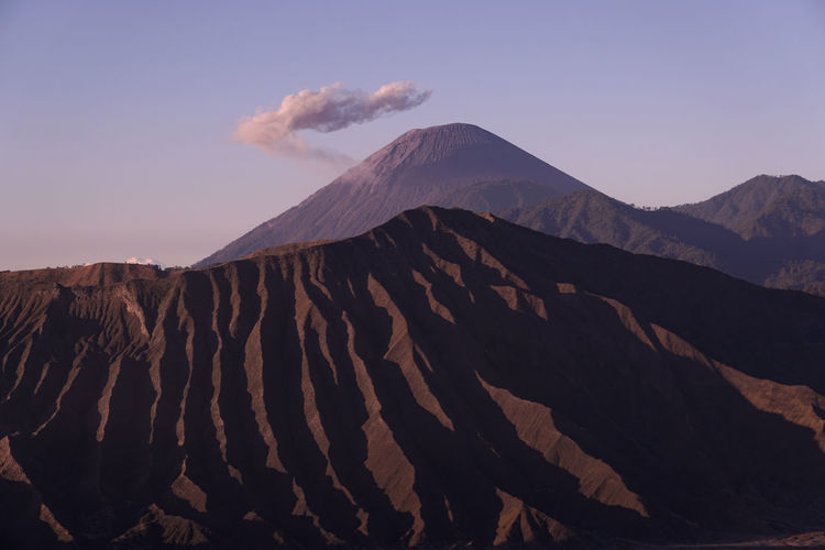 Mount semeru with a beautiful cloud crown and foreground bromo national park area, indonesia.