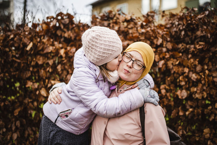 Full length of mother and daughter during autumn