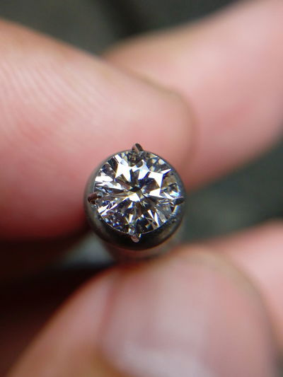 Close-up of jeweler holding diamond