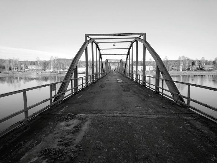 Bridge Over Water Against Sky